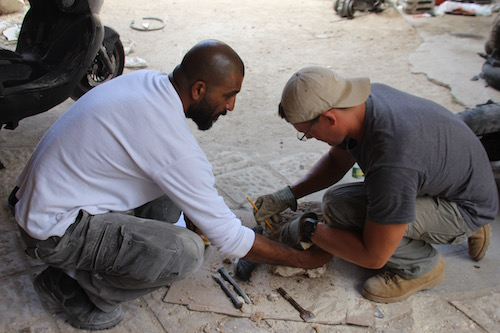 Salim and John cutting stones